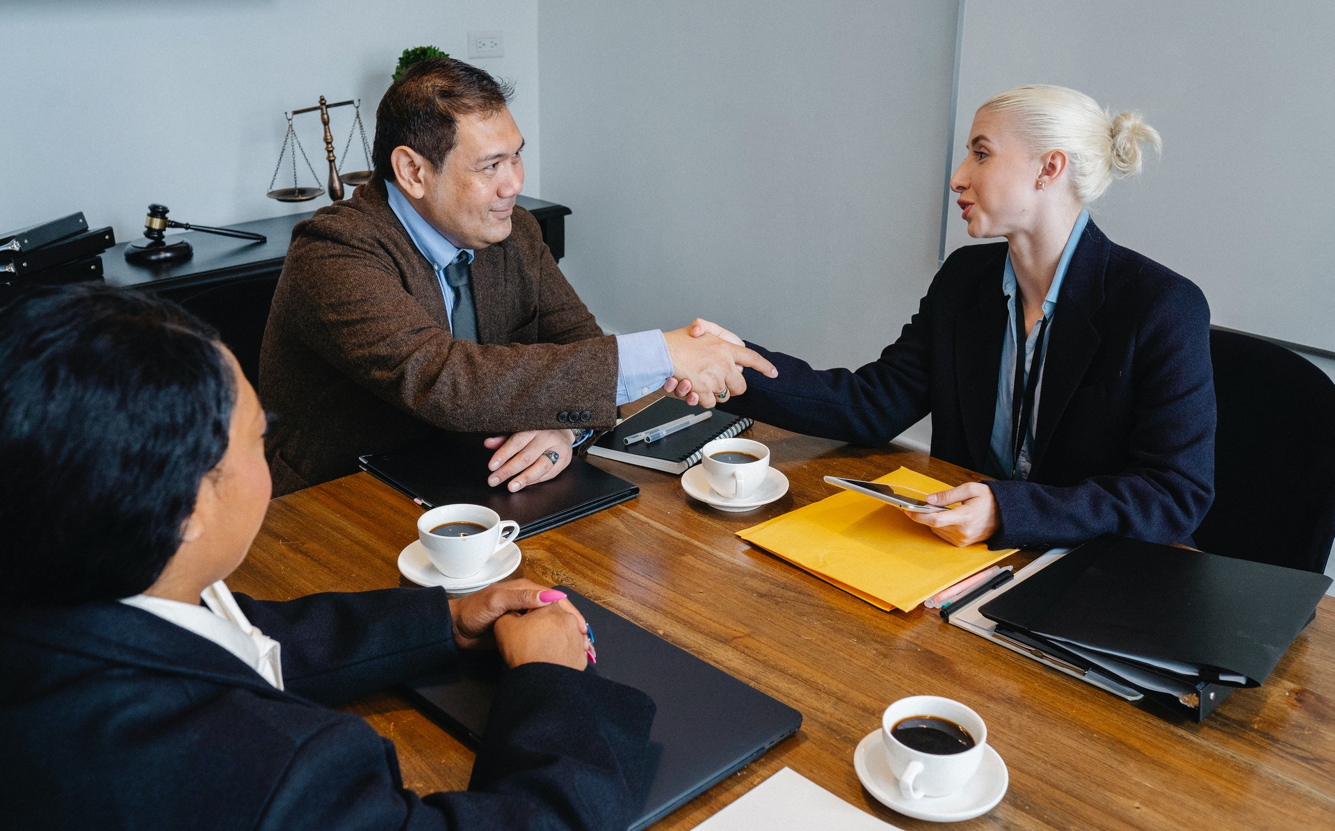 Business people shaking hands and completing a deal